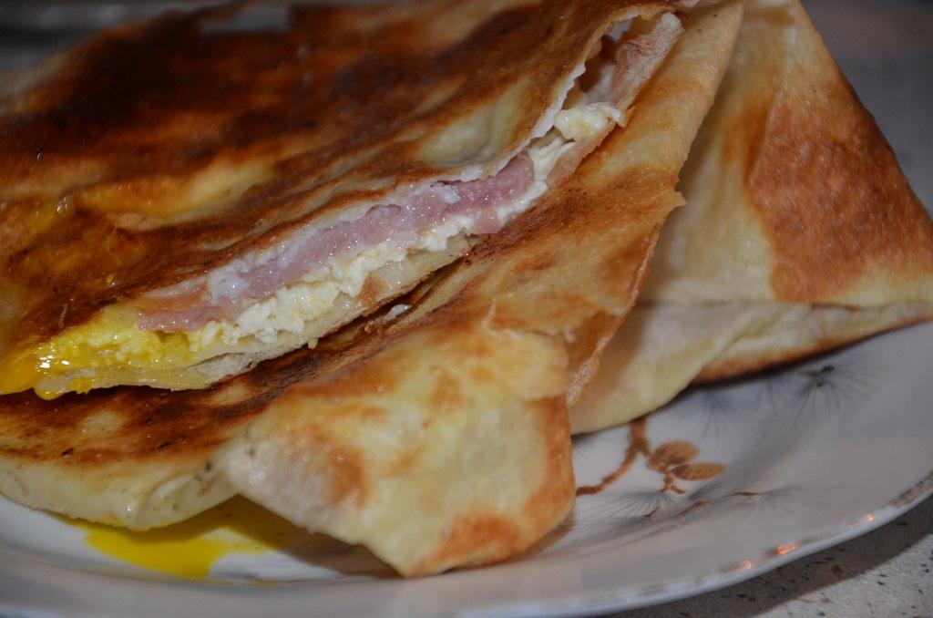 Yoka cheesy abkhazian omelette with flat bread for Abkhazian cuisine